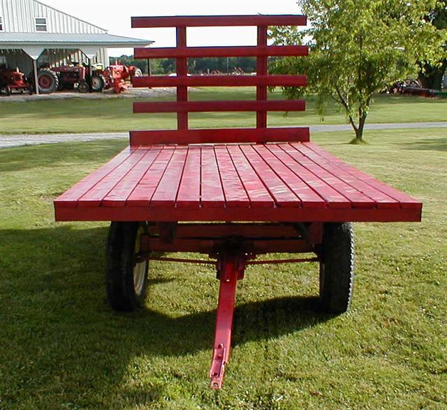 Red hay rack wagons for hay or hay rides for sale with or without hay