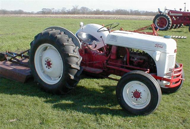 Ford 8N tractor with scrape blade and bush hog for sale