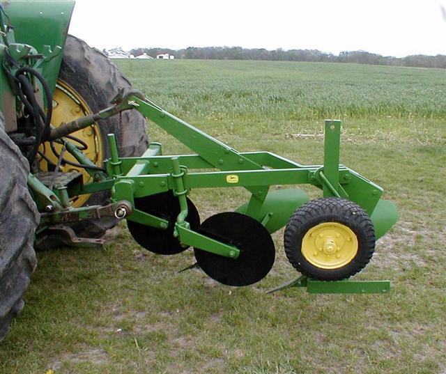 Three bottom plow parts Jay